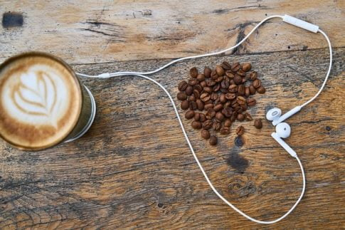 How to make a latte, spilled coffee beans and earphones