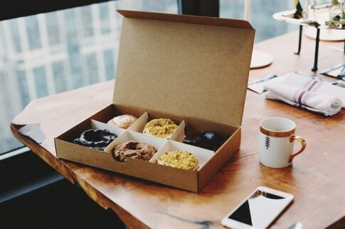 What is donut shop coffee, an open box of donuts with coffee