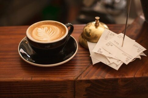How much do coffee shop owners make, cup of coffee and a receipt