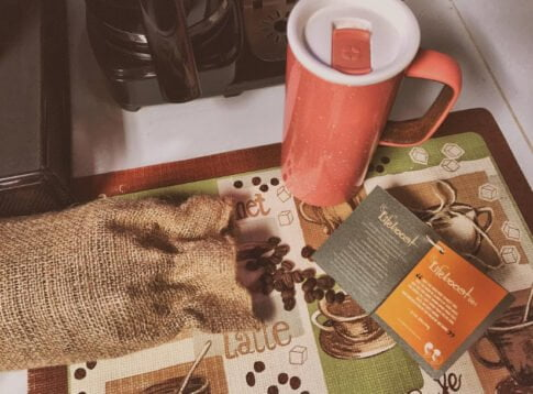 Lifeboost coffee review, coffee beans and mug