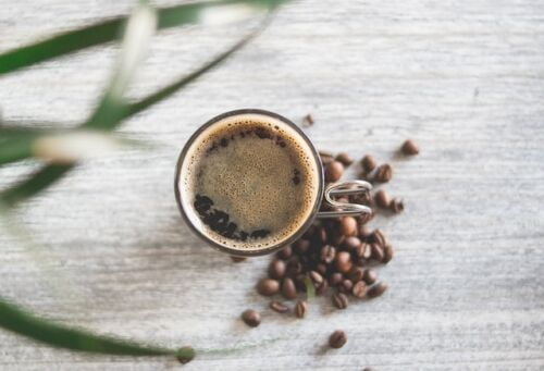 What is Keto coffee, a cup of coffee next to coffee beans