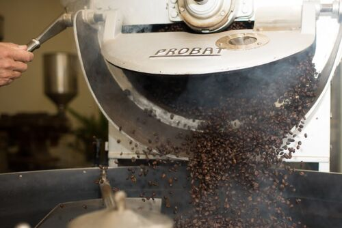 Types of Coffee Roasts, coffee beans coming out of a roaster