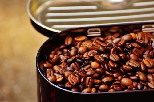 Types of Coffee Roasts, freshly roasted coffee in a container